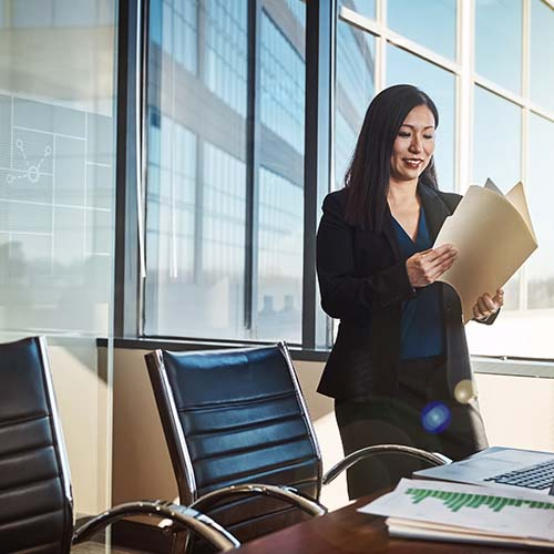 Smiling woman in office with documents